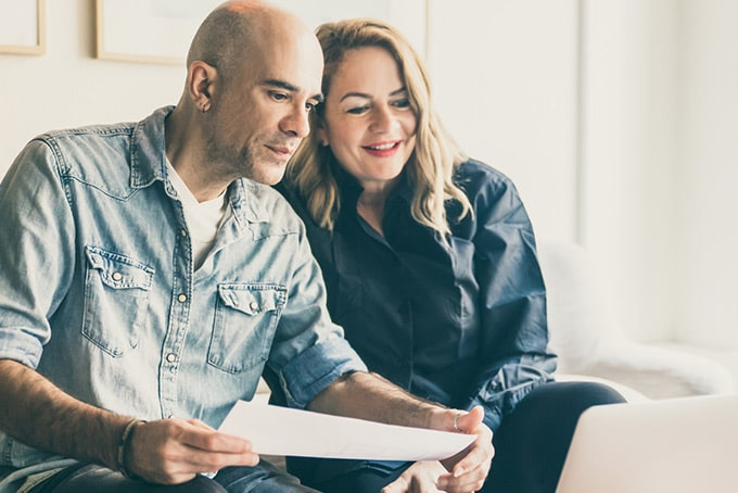 a couple reads their minimum payment disclosure together